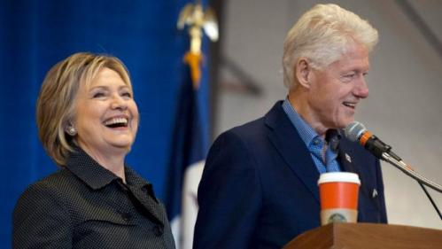 Former U.S. President Bill Clinton (L) and Democratic U.S. presidential candidate Hillary Clinton take the stage at the Central Iowa Democrats Fall Barbecue in Ames, Iowa November 15, 2015. REUTERS/Mark Kauzlarich