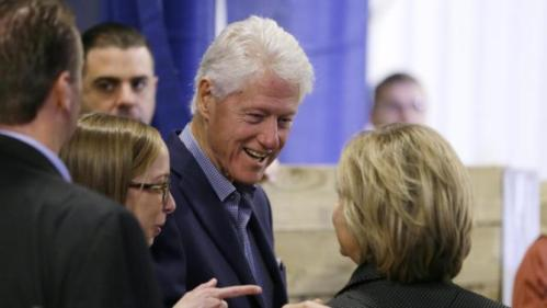 Former president Bill Clinton talks with his wife Democratic presidential candidate Hillary Rodham Clinton backstage at the Central Iowa Democrats Fall Barbecue Sunday, Nov. 15, 2015, in Ames, Iowa. (AP Photo/Charlie Neibergall)