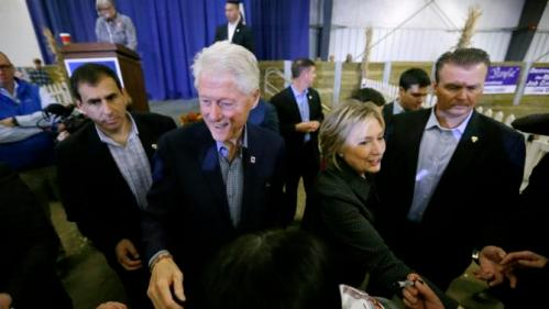 Former president Bill Clinton and his wife Democratic presidential candidate Hillary Rodham Clinton greet supporters at the Central Iowa Democrats Fall Barbecue Sunday, Nov. 15, 2015, in Ames, Iowa. (AP Photo/Charlie Neibergall)