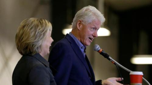 Democratic presidential candidate Hillary Rodham Clinton listens to her husband former President Bill Clinton speak at the Central Iowa Democrats Fall Barbecue Sunday, Nov. 15, 2015, in Ames, Iowa. (AP Photo/Charlie Neibergall)