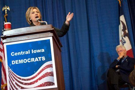 Democratic U.S. presidential candidate Hillary Clinton (L) speaks as Former U.S. president Bill Clinton listens at the Central Iowa Democrats Fall Barbecue in Ames, Iowa November 15, 2015. REUTERS/Mark Kauzlarich