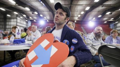 Jim West, of Chicago, Ill., listens to Democratic presidential candidate Hillary Rodham Clinton speak at the Central Iowa Democrats Fall Barbecue Sunday, Nov. 15, 2015, in Ames, Iowa. (AP Photo/Charlie Neibergall)