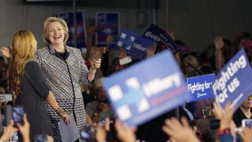 Democratic presidential candidate Hillary Rodham Clinton laughs after she was introduced at a campaign event at Mountain View Community College, Tuesday, Nov. 17, 2015, in Dallas. (AP Photo/LM Otero)