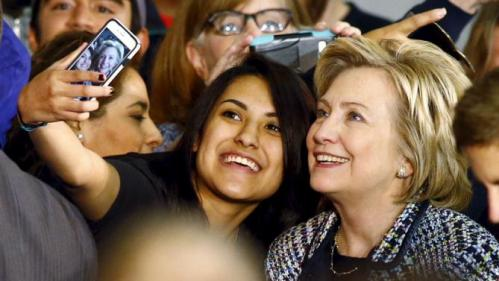 Democratic U.S. presidential candidate Hillary Clinton poses for a selfie with a supporter at a Grassroots Organizing Event at Mountain View College in Dallas, Texas, November 17, 2015. REUTERS/Mike Stone