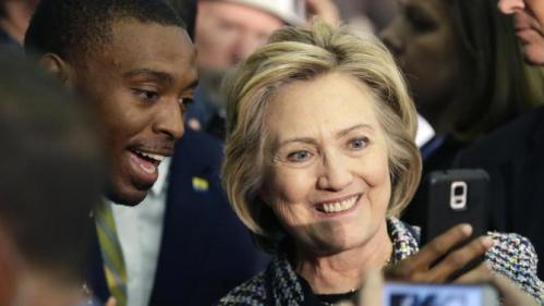 Democratic presidential candidate Hillary Rodham Clinton poses for cell phone photos after speaking at a campaign event at Mountain View Community College, Tuesday, Nov. 17, 2015, in Dallas. (AP Photo/LM Otero)