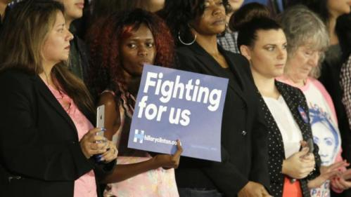 A supporter holds a sign for Democratic presidential candidate Hillary Rodham Clinton during a campaign event at Mountain View Community College, Tuesday, Nov. 17, 2015, in Dallas. (AP Photo/LM Otero)