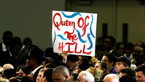 A supported holds a sign for Democratic presidential candidate Hillary Rodham Clinton during a campaign event at Mountain View Community College, Tuesday, Nov. 17, 2015, in Dallas. (AP Photo/LM Otero)