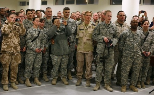 International troops listen to a speech by U.S. State Secretary Hillary Clinton during a meeting at Kabul airport before her departure from Afghanistan November 19, 2009. REUTERS/Jerry Lampen (AFGHANISTAN POLITICS CONFLICT MILITARY)