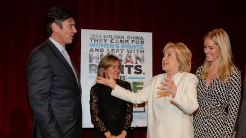 """Democratic presidential candidate Hillary Rodham Clinton, second from right, greets AOL chairman and CEO Tim Armstrong, left, before the premiere of the movie """"Makers: Once and for All,"""" Thursday, Nov. 19, 2015, in New York. The movie chronicles the months in 1995 leading up to the U.N. Fourth World Conference on Women in Beijing which Clinton attended. (AP Photo/Julie Jacobson)"""