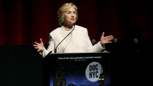 """Democratic U.S. presidential candidate Hillary Clinton makes remarks on stage before the premiere of the documentary film """"Makers: Once And For All"""" at the DOC NYC documentary film festival in the Manhattan borough of New York City, November 19, 2015. """"Makers: Once And For All"""" tells the story of the 1995 Beijing Women's Conference and features commentary from the former U.S. First Lady and Secretary of State. REUTERS/Mike Segar"""