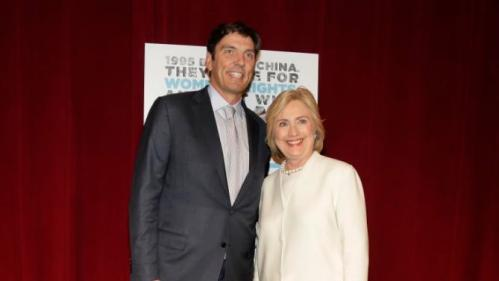 "Democratic presidential candidate Hillary Rodham Clinton, right, poses for a photo with AOL chairman and CEO Tim Armstrong before the premiere of the movie ""Makers: Once and for All,"" Thursday, Nov. 19, 2015, in New York. The movie chronicles the months in 1995 leading up to the U.N. Fourth World Conference on Women in Beijing which Clinton attended. (AP Photo/Julie Jacobson)"