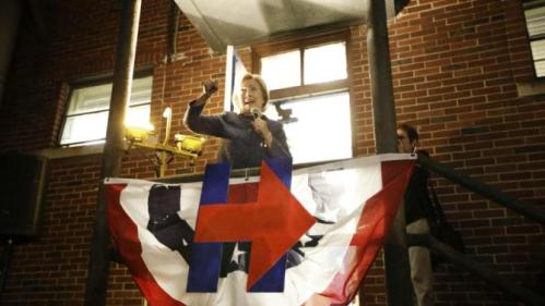 Democratic presidential candidate Hillary Rodham Clinton speaks from a gymnasium side porch to people who weren't able to fit in to hear her speech at Fisk University Friday, Nov. 20, 2015, in Nashville, Tenn. (AP Photo/Mark Humphrey)