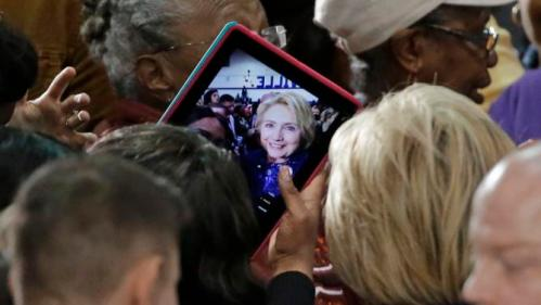 A woman takes a selfie with Democratic presidential candidate Hillary Rodham Clinton after Clinton spoke at Fisk University Friday, Nov. 20, 2015, in Nashville, Tenn. (AP Photo/Mark Humphrey)