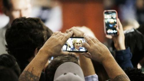 A man photographs Democratic presidential candidate Hillary Rodham Clinton after she spoke at Fisk University Friday, Nov. 20, 2015, in Nashville, Tenn. (AP Photo/Mark Humphrey)