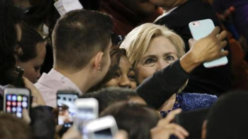 A supporter takes a selfie with Democratic presidential candidate Hillary Rodham Clinton at Fisk University Friday, Nov. 20, 2015, in Nashville, Tenn. (AP Photo/Mark Humphrey)