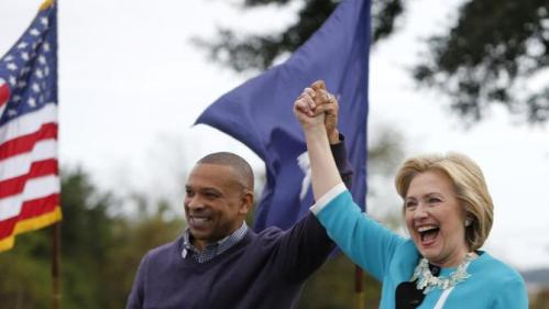 Democratic presidential candidate Hillary Rodham Clinton acknowledges the crowd at the Jenkins Orphanage in North Charleston, S.C., Saturday, Nov. 21, 2015, with S.C. State Sen. Marlon Kimpson during the Blue Jamboree event. (AP Photo/Mic Smith)
