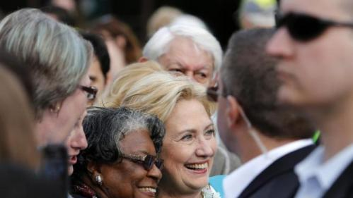 Democratic presidential candidate Hillary Rodham Clinton takes pictures with supporters after speaking to the crowd at the Jenkins Orphanage in North Charleston, S.C., Saturday, Nov. 21, 2015, during the Blue Jamboree event. (AP Photo/Mic Smith)