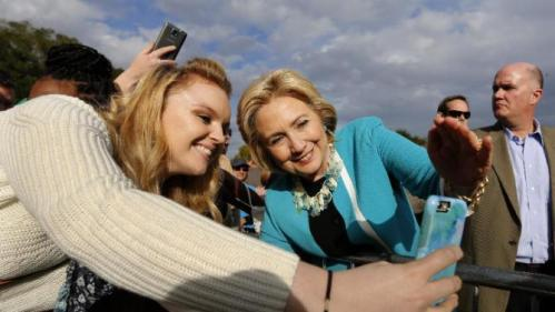 Democratic presidential candidate Hillary Rodham Clinton takes a photo with a supporter after her speech at the Jenkins Orphanage in North Charleston, S.C., Saturday, Nov. 21, 2015, during the Blue Jamboree event. (AP Photo/Mic Smith)