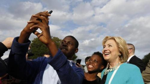 Democratic presidential candidate Hillary Rodham Clinton works the crowd at the Jenkins Orphanage in North Charleston, S.C., Saturday, Nov. 21, 2015, during the Blue Jamboree event. (AP Photo/Mic Smith)