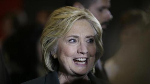 Democratic presidential candidate Hillary Rodham Clinton greets supporters after speaking at a town hall meeting Sunday, Nov. 22, 2015, in Clinton, Iowa. (AP Photo/Charlie Neibergall)