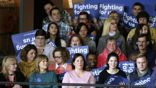 Audience members wait for Democratic presidential candidate Hillary Rodham Clinton to speak at a town hall meeting Sunday, Nov. 22, 2015, in Clinton, Iowa. (AP Photo/Charlie Neibergall)