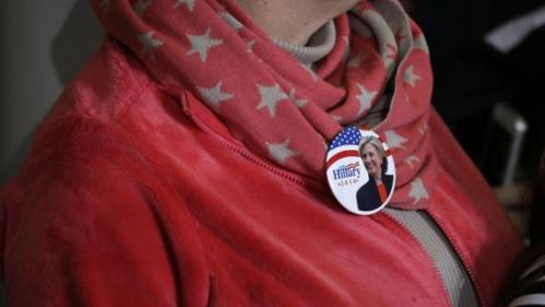 An audience member wears a campaign button of Democratic presidential candidate Hillary Rodham Clinton during a town hall meeting Sunday, Nov. 22, 2015, in Clinton, Iowa. (AP Photo/Charlie Neibergall)