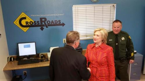 Democratic presidential candidate Hillary Rodham Clinton meets Steven Edwards, program manager at the Crossroads substance abuse treatment center during a campaign stop Monday, Nov. 23, 2015 in Reno, Nev. Clinton said she hoped the program could be replicated elsewhere. (AP Photo/Michelle Rindels)