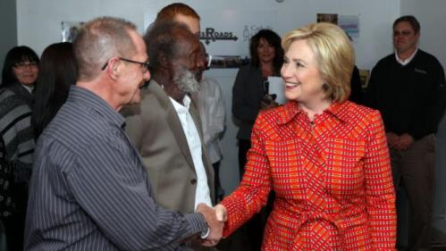 Democratic presidential candidate Hillary Rodham Clinton meets Mike McClean, a recovering alcoholic, during a tour of Crossroads an Substance Abuse Facility sponsored by Catholic Charities of Northern Nevada Monday, Nov. 23, 2015, in Reno, Nev. (AP Photo/Lance Iversen)