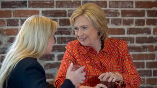 Democratic Presidential candidate Hillary Clinton visits with Mayor Hillary Schieve at Coffee Bar in Reno, Nevada November 23, 2015. REUTERS/James Glover II