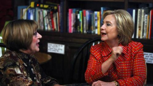 Democratic presidential candidate Hillary Rodham Clinton meets with Democratic Party chairman Marty McGarry at the Comma Coffee House in Carson City, Nev., Monday, Nov. 23, 2015, (AP Photo/Lance Iversen)