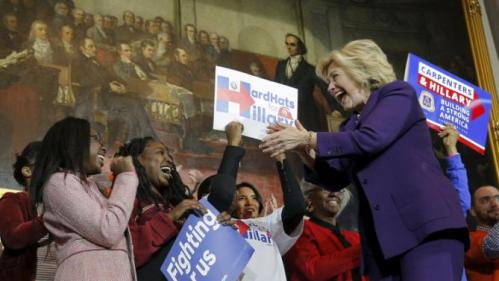 U.S. Democratic presidential candidate Hillary Clinton greets supporters representing labor unions as she takes the stage for a campaign rally at Faneuil Hall in Boston, Massachusetts November 29, 2015. REUTERS/Brian Snyder