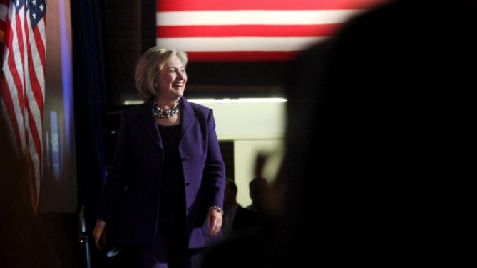 U.S. Democratic presidential candidate Hillary Clinton smiles as she takes the stage at the New Hampshire Democratic Party's Jefferson Jackson dinner in Manchester, New Hampshire November 29, 2015. REUTERS/Mary Schwalm