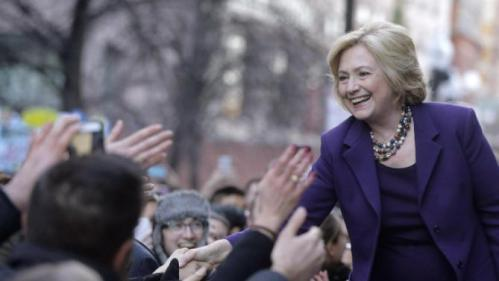 "Democratic presidential candidate Hillary Clinton, right, greets people in a crowd before a rally at Faneuil Hall, Sunday, Nov. 29, 2015, in Boston. Clinton and Boston Mayor Marty Walsh attended the event held to launch ""Hard Hats for Hillary,"" a coalition to organize working families in construction, building, transportation, and other labor industries to support Clinton's agenda. (AP Photo/Steven Senne)"