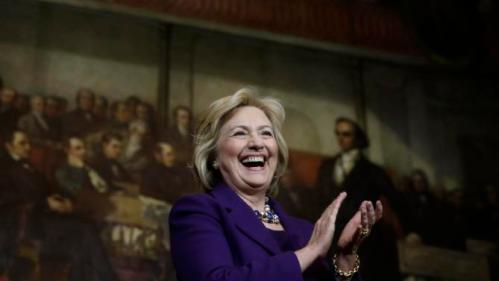 "Democratic presidential candidate Hillary Clinton smiles on stage at the start of a rally, Sunday, Nov. 29, 2015, in Boston. Clinton and Boston Mayor Marty Walsh attended the event to launch ""Hard Hats for Hillary,"" a coalition to organize working families in construction, building, transportation, and other labor industries to support Clinton's agenda. (AP Photo/Steven Senne)"