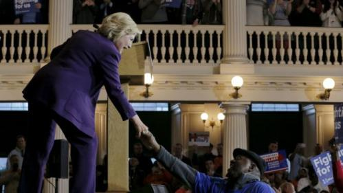 U.S. Democratic presidential candidate Hillary Clinton greets an audience member at the conclusion of a campaign rally with labor unions at Faneuil Hall in Boston, Massachusetts November 29, 2015. REUTERS/Brian Snyder