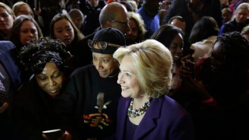 Democratic presidential candidate Hillary Clinton, center, stands with people in the crowd for a photograph at the conclusion of a rally at Faneuil Hall, Sunday, Nov. 29, 2015, in Boston. (AP Photo/Steven Senne)