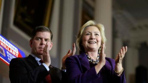 "Democratic presidential candidate Hillary Clinton, right, applauds with Boston Mayor Marty Walsh, left, on stage at the conclusion of a rally at Faneuil Hall, Sunday, Nov. 29, 2015, in Boston. The event was held to launch ""Hard Hats for Hillary,"" a coalition created to organize people in industries and labor to support Clinton's agenda. (AP Photo/Steven Senne)"