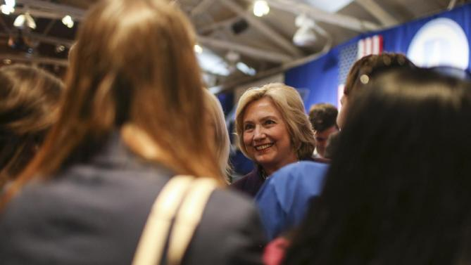 Democratic presidential candidate Hillary Clinton greets supporters after speaking at the New Hampshire Democrats party's annual dinner in Manchester, N.H., Sunday, Nov. 29, 2015. (AP Photo/Cheryl Senter)