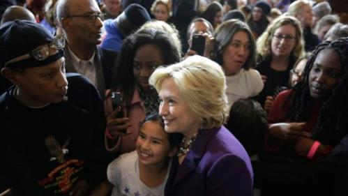 "Democratic presidential candidate Hillary Clinton, center, stands with people in the crowd for photographs at the conclusion of a rally at Faneuil Hall, Sunday, Nov. 29, 2015, in Boston. Clinton and Boston Mayor Marty Walsh attended the event held to launch ""Hard Hats for Hillary,"" a coalition created to organize people in industries and labor to support Clinton's agenda. (AP Photo/Steven Senne)"