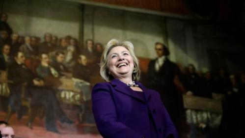 "Democratic presidential candidate Hillary Clinton smiles on stage at the start of a rally, Sunday, Nov. 29, 2015, in Boston. Clinton and Boston Mayor Marty Walsh attended the event held to launch ""Hard Hats for Hillary,"" a coalition to organize working families in construction, building, transportation, and other labor industries to support Clinton's agenda. (AP Photo/Steven Senne)"