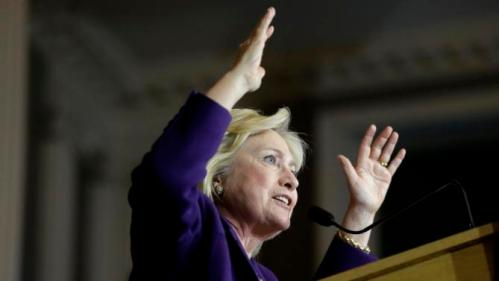"Democratic presidential candidate Hillary Clinton addresses an audience at a rally at Faneuil Hall, Sunday, Nov. 29, 2015, in Boston. The event was held to launch ""Hard Hats for Hillary,"" a coalition created to organize people in industries and labor to support Clinton's agenda. (AP Photo/Steven Senne)"