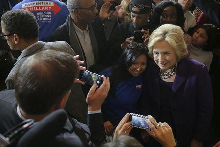 U.S. Democratic presidential candidate Hillary Clinton poses for a photograph with audience members during a campaign rally with labor unions at Faneuil Hall in Boston, Massachusetts November 29, 2015. REUTERS/Brian Snyder