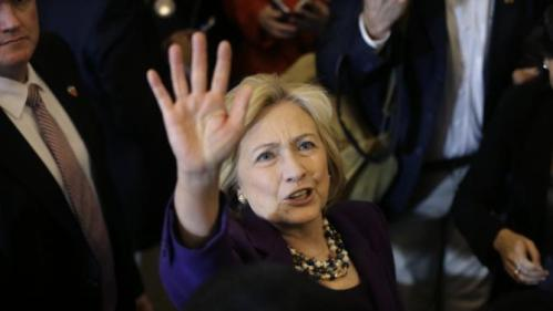 "Democratic presidential candidate Hillary Clinton waves to people in a crowd at the conclusion of a rally at Faneuil Hall, Sunday, Nov. 29, 2015, in Boston. Clinton and Boston Mayor Marty Walsh attended the event held to launch ""Hard Hats for Hillary,"" a coalition created to organize people in industries and labor to support Clinton's agenda. (AP Photo/Steven Senne)"