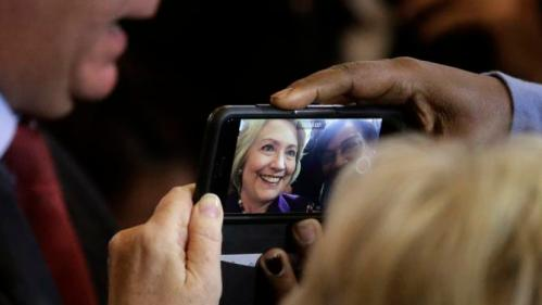 "Democratic presidential candidate Hillary Clinton poses for a selfie while greeting people in the crowd at the conclusion of a rally at Faneuil Hall, Sunday, Nov. 29, 2015, in Boston. Clinton and Boston Mayor Marty Walsh, top left, attended the event held to launch ""Hard Hats for Hillary,"" a coalition created to organize people in industries and labor to support Clinton's agenda. (AP Photo/Steven Senne)"