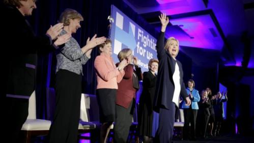 "Democratic presidential candidate Hillary Clinton waves as she joins 13 female senators for a ""Women for Hillary"" endorsement event and fundraiser in Washington November 30, 2015. REUTERS/Joshua Roberts"