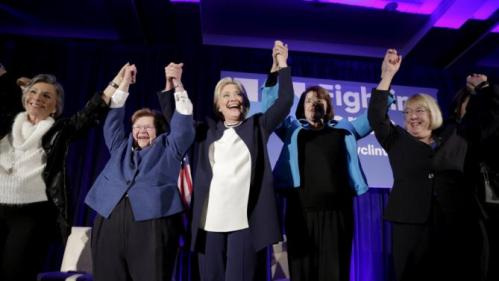 "Democratic presidential candidate Hillary Clinton (C) raises her arms while joining 13 female senators for a ""Women for Hillary"" endorsement event and fundraiser in Washington November 30, 2015. With her are (from left): Senators Barbara Boxer (D-CA), Barbara Mikulski (D-MD), Dianne Feinstein (D-CA) and Patty Murray (D-WA). REUTERS/Joshua Roberts"