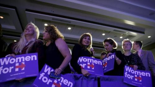 "Supporters of Democratic presidential candidate Hillary Clinton wait for her to join 13 female senators for a ""Women for Hillary"" endorsement event and fundraiser in Washington November 30, 2015. REUTERS/Joshua Roberts"