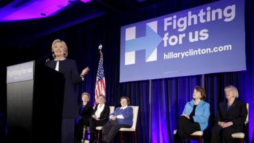 "Democratic presidential candidate Hillary Clinton speaks as 13 female senators join a ""Women for Hillary"" endorsement event and fundraiser in Washington November 30, 2015. REUTERS/Joshua Roberts"