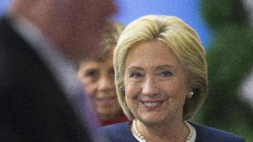 Democratic presidential candidate Hillary Clinton smiles as she walks off-stage after speaking at the Atlantic Council Women's Leadership in Latin America Initiative in Washington, Monday, Nov. 30, 2015. (AP Photo/Pablo Martinez Monsivais)