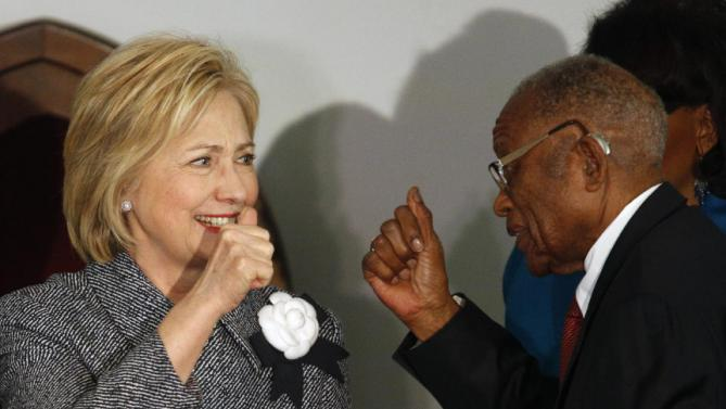 Democratic presidential candidate Hillary Clinton greets and gives a thumbs-up to Fred Gray, Rosa Parks former attorney, before speaking at the Dexter Avenue King Memorial Baptist Church, Tuesday, Dec. 1, 2015, in Montgomery, Ala. Mrs. Clinton's keynote address is part of a two-day event put on by the National Bar Association in recognition of the 60th anniversary of the Montgomery city bus boycott witch began after Rosa Parks refused to give up her seat to a white man. (AP Photo/ Hal Yeager)